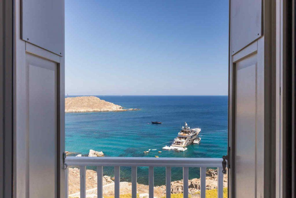 beautiful view from villas balkony of yacht and sea
