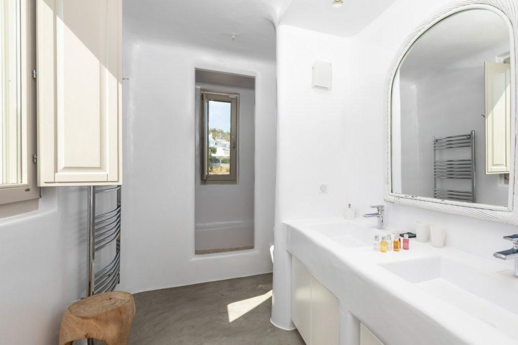 white luxurious bathroom with shower and mirror
