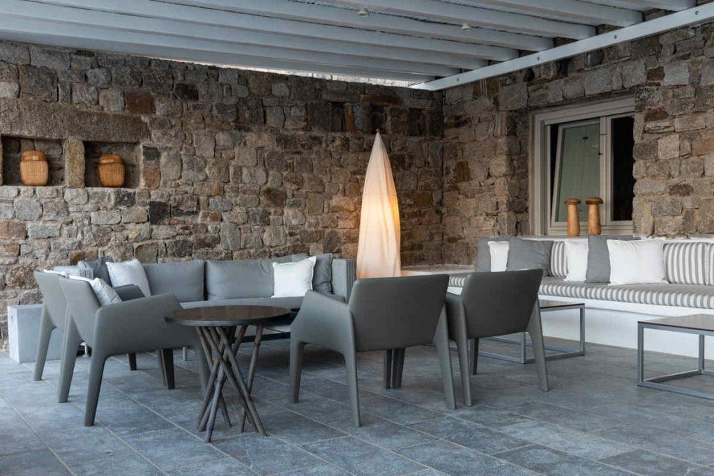 outdoor dining area with grey chairs for better relaxing