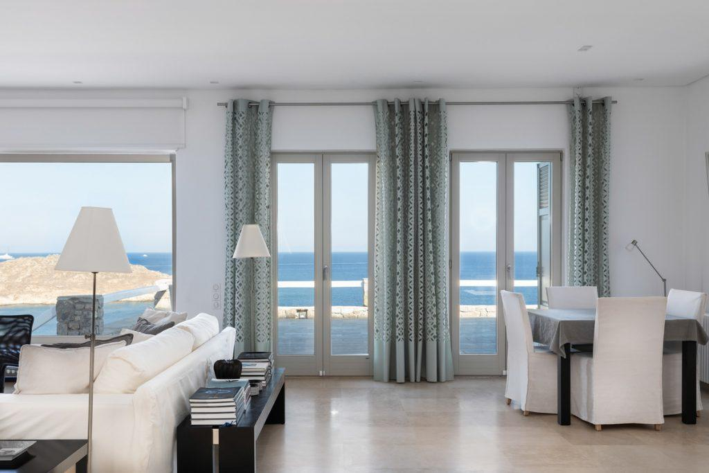 living area with modern designed furniture and view of blue sea