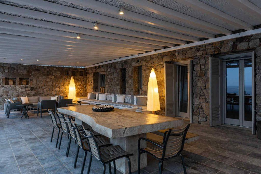 outdoor dining area with accessories and lamp