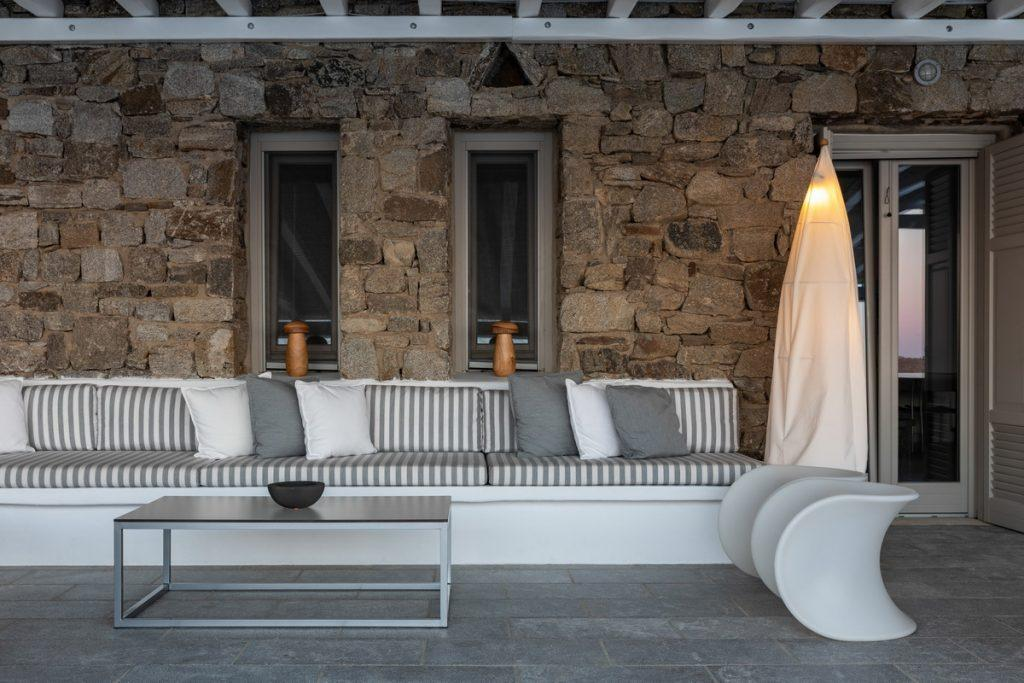 outdoor living area with soft pillows and rocky wall