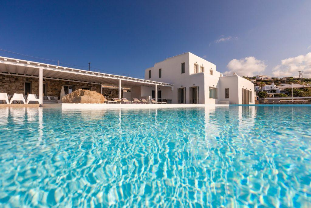 balcony with swimming pool and outdoor view of the city of mykonos