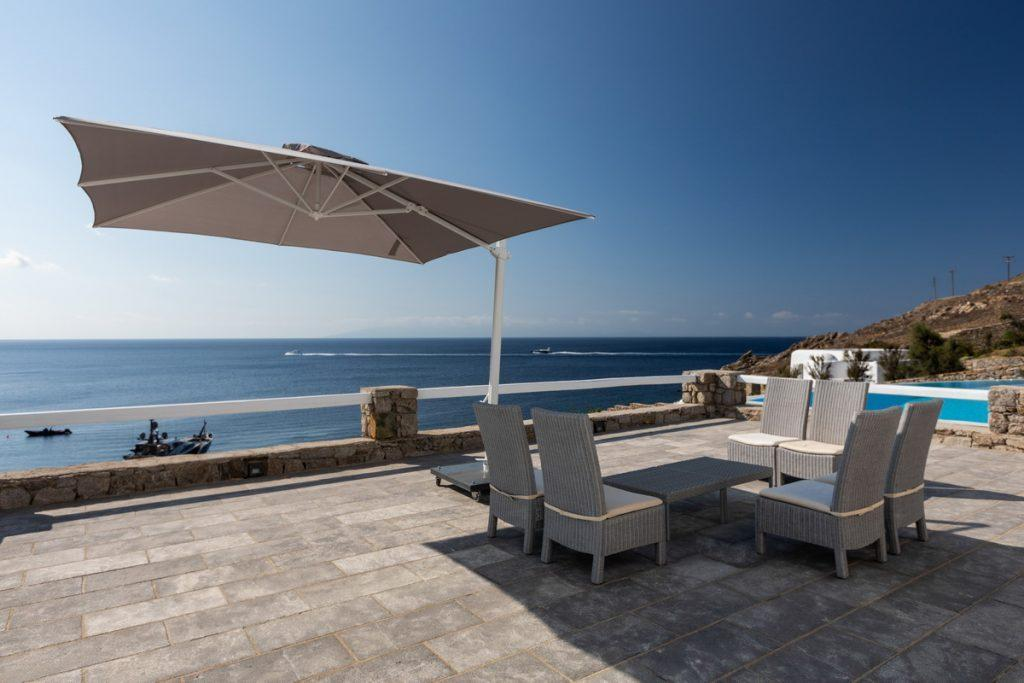balcony with sun shield and view of beautiful sea