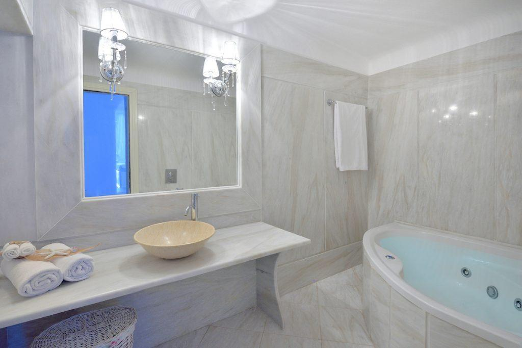 bathroom with huge mirror and for showering