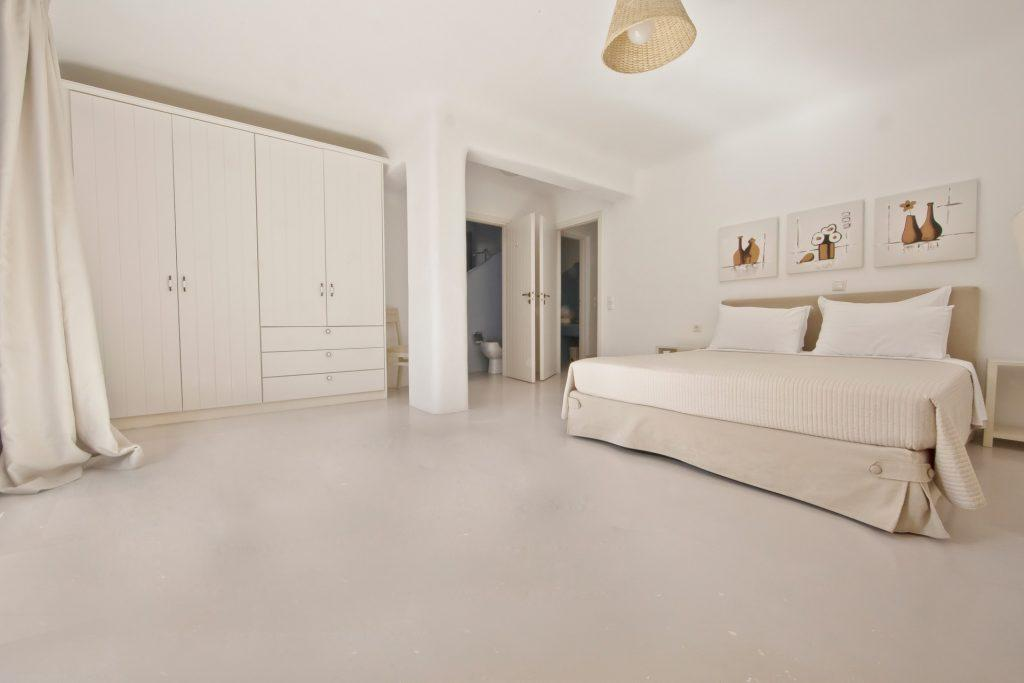 bedroom with tiled floor and comfort bed