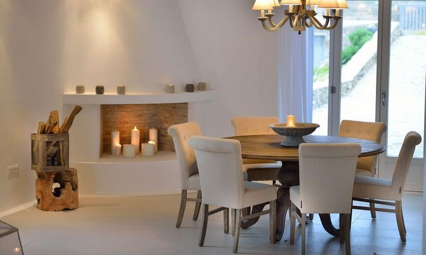dining area with candles and fireplace for better atmosphere