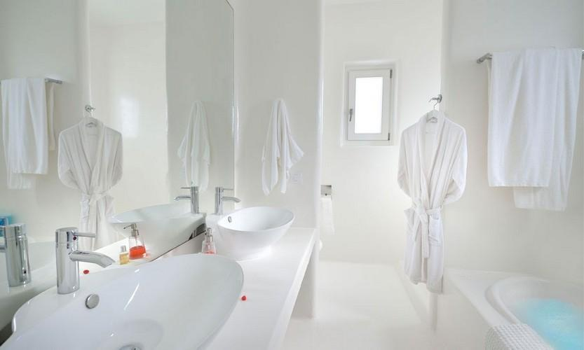 white wall bathroom with bath and huge clean mirror