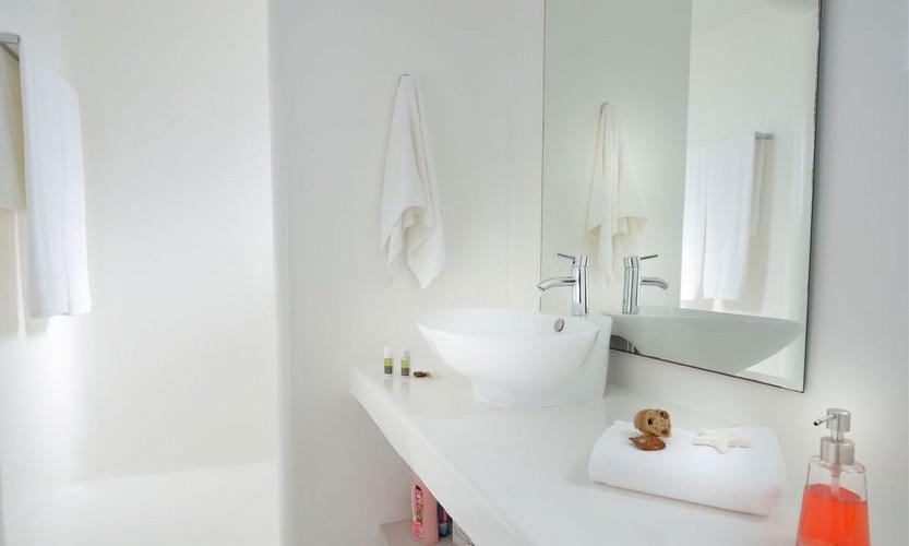 simply designed bathroom with huge mirror and soft towels