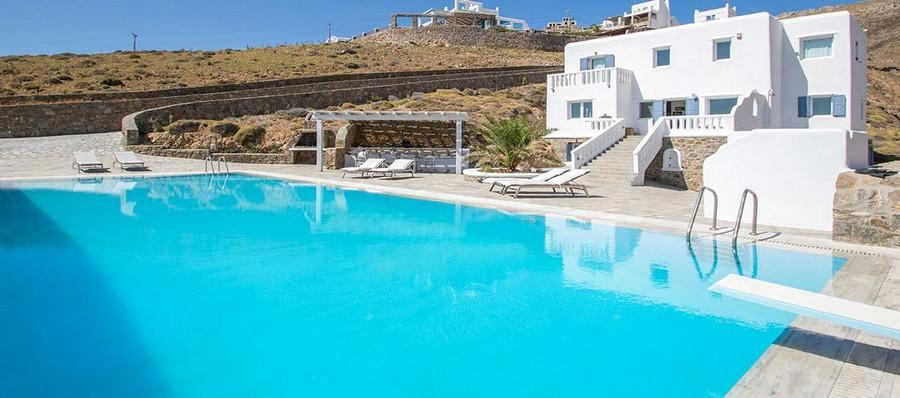 outdoor area with pool board and sunbeds for sunbathing