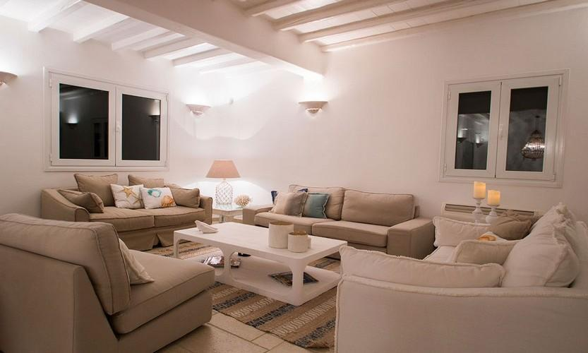 broad living room with four comfortable couches with enough space for you and your friends to relax in the evening