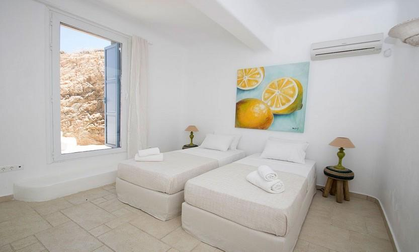 practicaly organized double single bedded bedroom with window cliff view and air conditioner