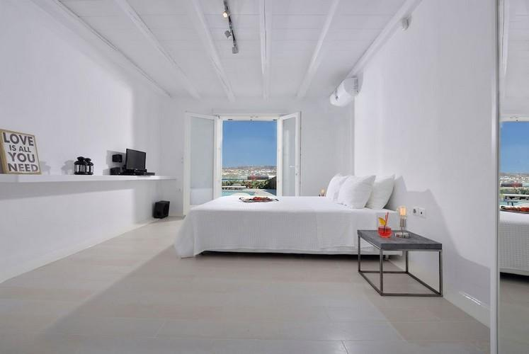 white wall bedroom with bed and air condition