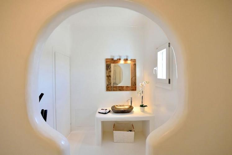 bathroom with shower and lit mirror