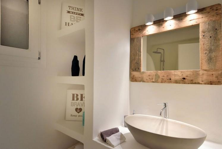 bathroom with lit mirror and ceramic sink