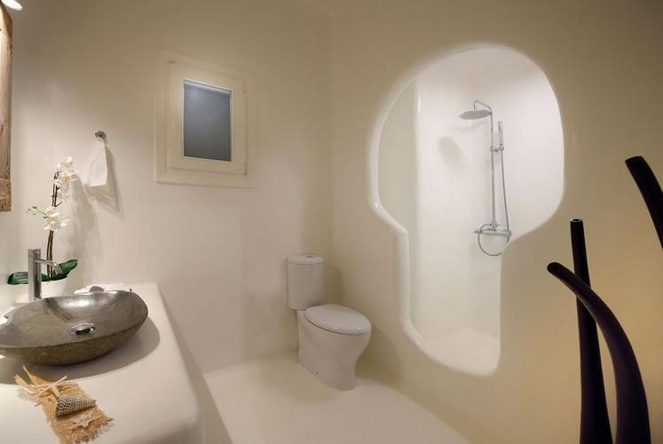 bathroom with small window and soft towels