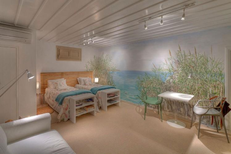 modernly decorated room with decoratively painted walls that contribute to a pleasant atmosphere
