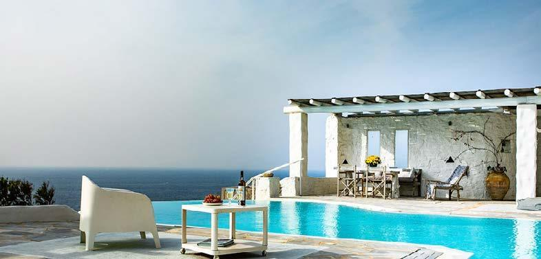 outdoor area with infinity pool and white chair to sit and enjoy in wine
