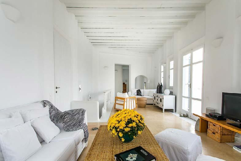 living area with comfort couch and flowers for better atmosphere