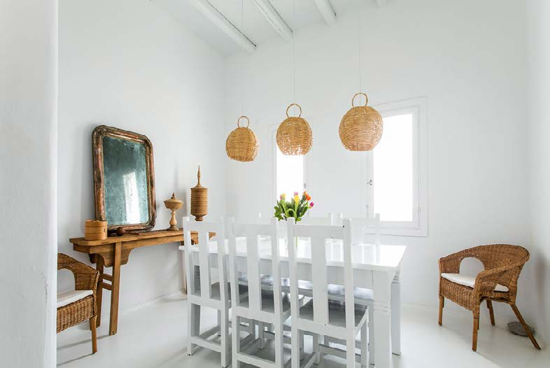 dining area with white table chairs and chandelier