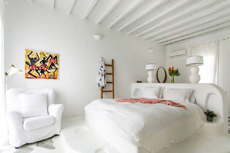 spacious bedroom with cozy huge bed and wall paints
