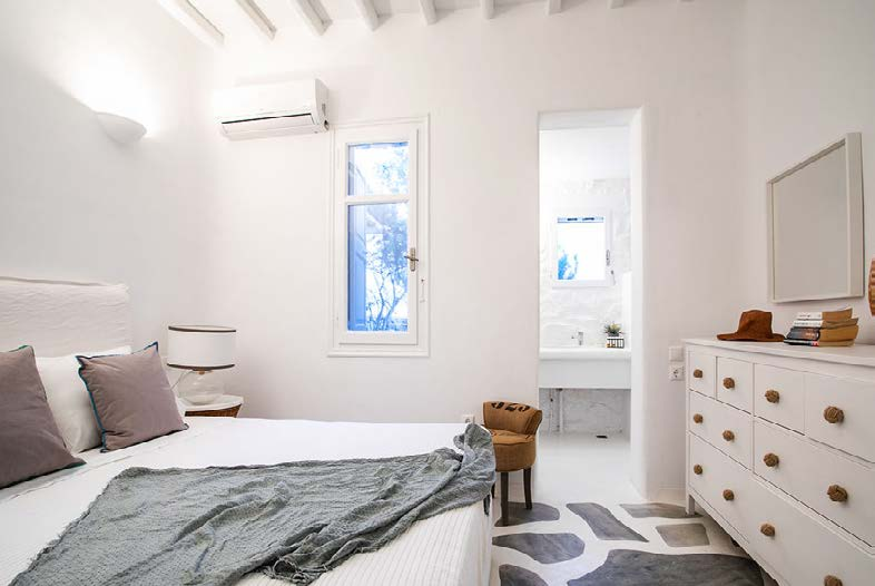 bedroom with tiled floor comfort bed and air condition