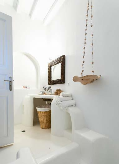 bathroom with basket and lit mirror