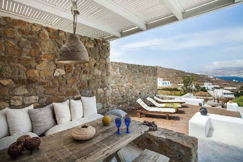 outdoor living area with comfort couch and wooden table