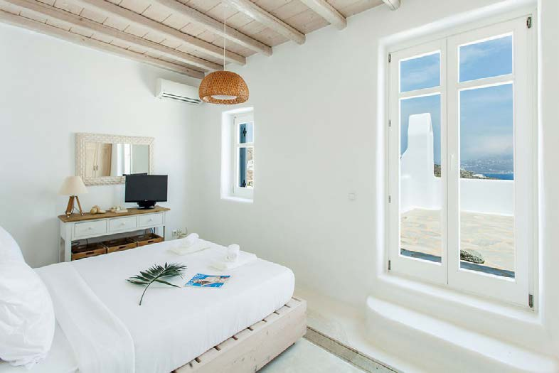 bedroom with air condition and cozy bed