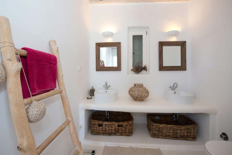 simply designed bathroom with wall lamps and washstand