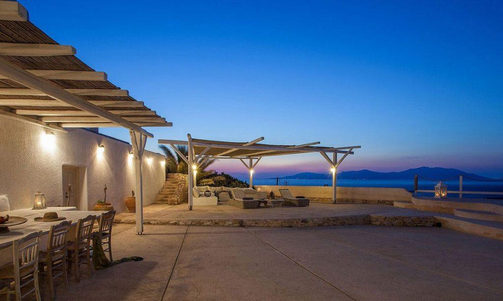 outdoor area with lit villa walls and canopy