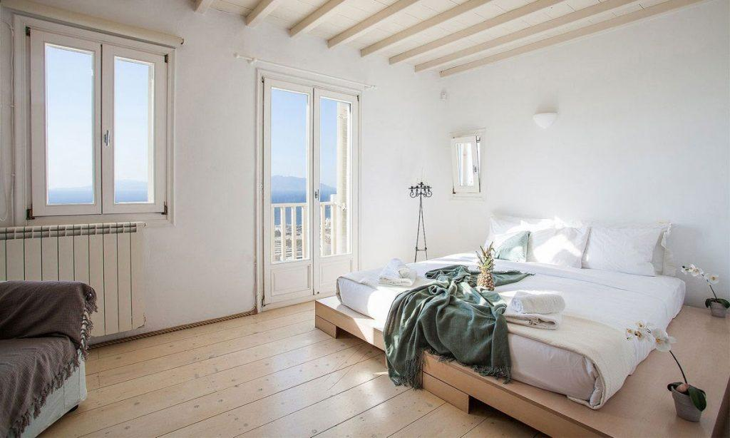 bedroom with wooden floor and huge soft bed