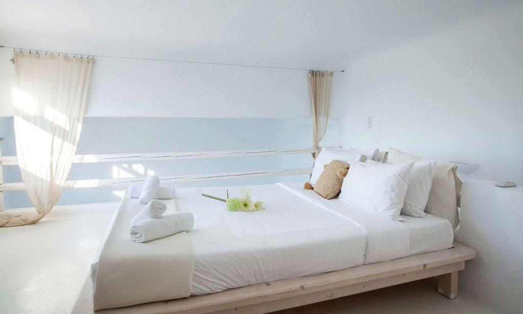 white wall bedroom with comfort bed and soft pillows