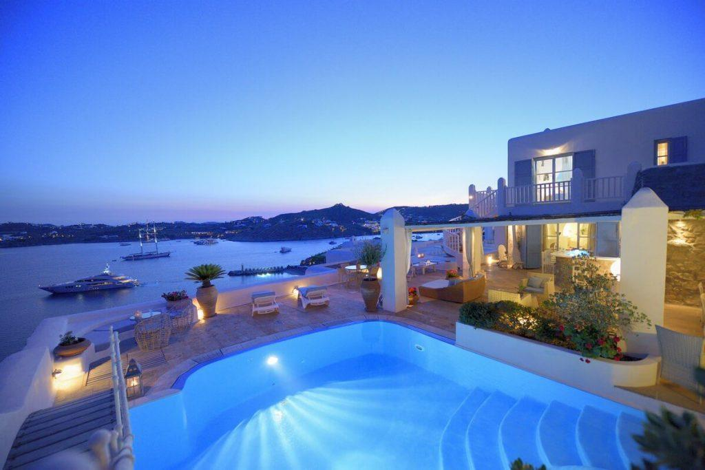 outdoor area with illuminated pool ideal for parties