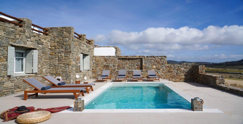 Villa-Carelia_05.jpg Kalafatis Mykonos, outdoor, pool, climbers, towels, hat, clouds, sky, island