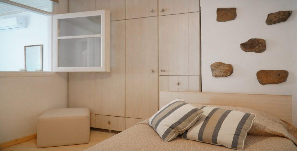 simply designed room with wooden cabins and floor