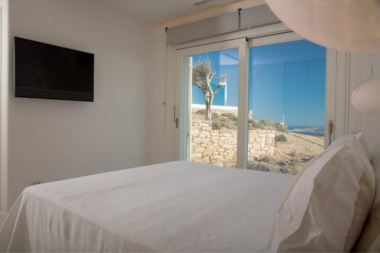 Villa_Nika_18.jpg Tourlos Mykonos 1st Bedroom, flat screen tv, bed, pillows