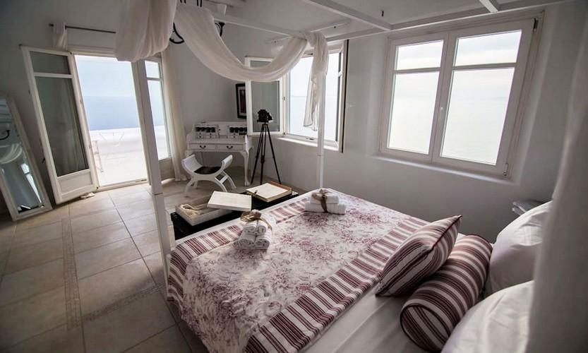 Villa_Star1_15.jpg Kanalia Mykonos 1st Bedroom, double bed, pillows, towels, chair, curtains