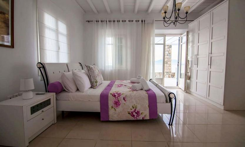 Villa_Star1_17.jpg Kanalia Mykonos 2nd Bedroom, double bed, pillows, paint, lamp, curtains