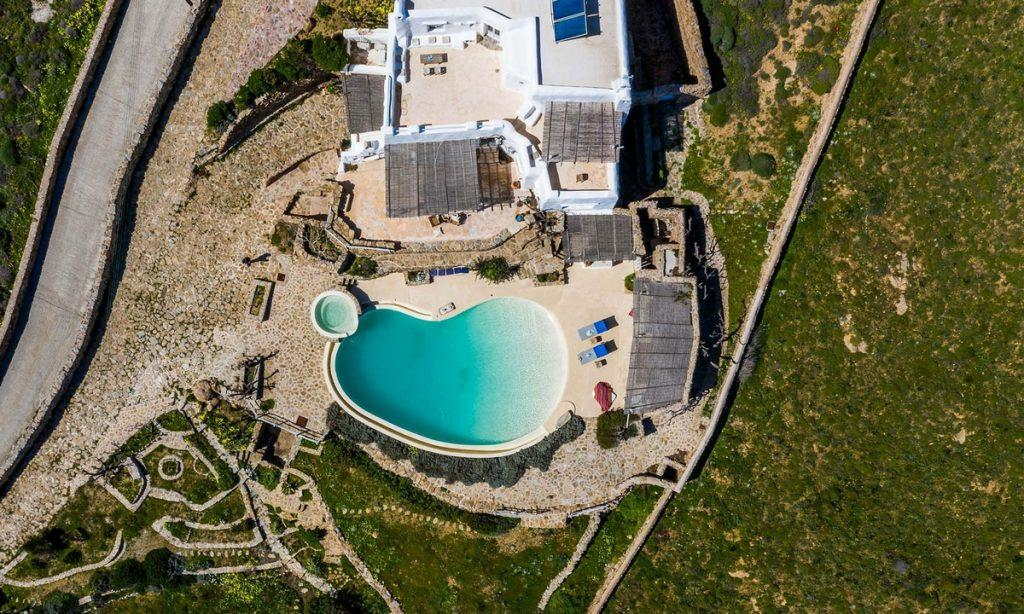 view on yard and beautiful shaped pool