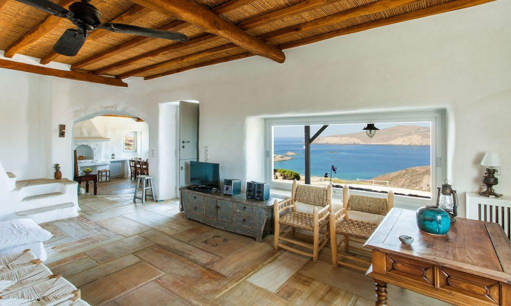 Villa Bob Agios Sostis Mykonos, living room, table, chairs, flat screen TV, home stereo system, window