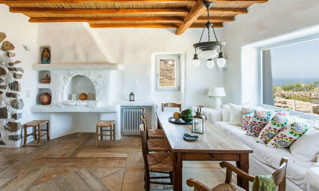 Villa Bob Agios Sostis Mykonos, living room, dining table, sofa, pillows, lamp, chairs, watermelon