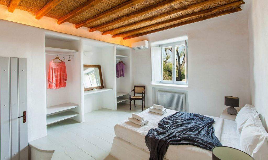 Villa Bob Agios Sostis Mykonos, 2nd bedroom, bed, towels, robes, pillows, lamps, nightstands, mirror, AC, closet, chair