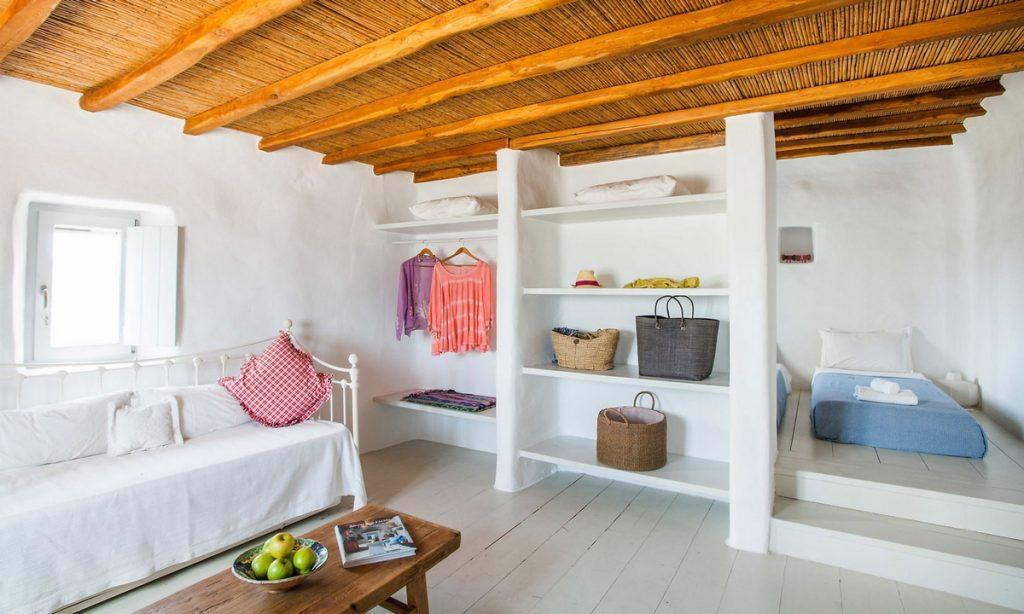 Villa Bob Agios Sostis Mykonos, 1st bedroom, double bed, towels, robe, pillows, sofa, book, bag, bowl, table