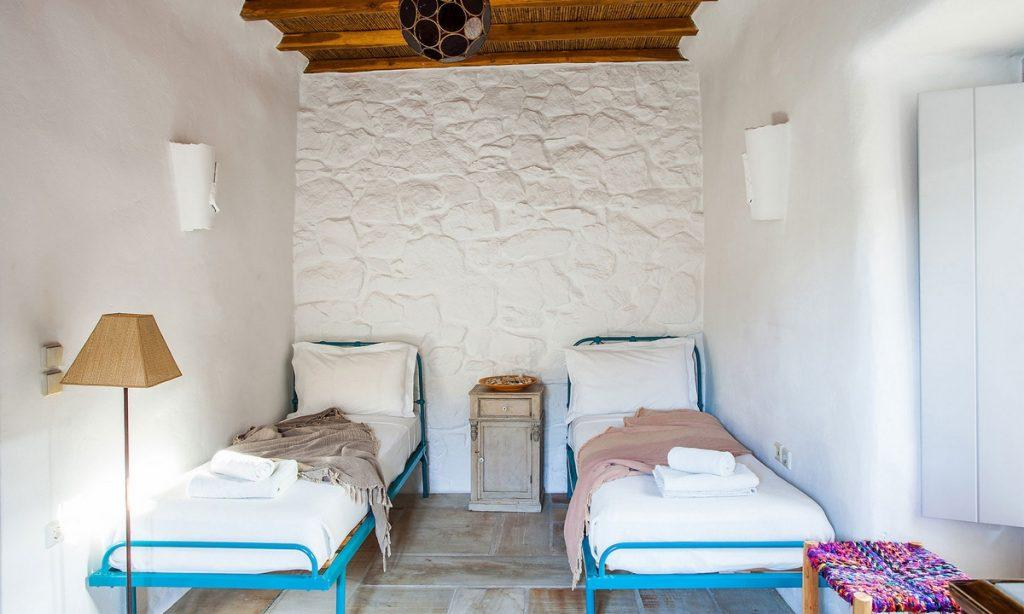Villa Bob Agios Sostis Mykonos, 3rd bedroom, double bed, lamp, nightstand, pillows, towels, robes, chair
