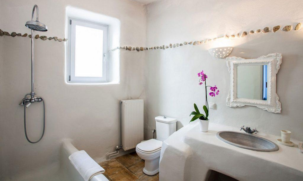 Villa Bob Agios Sostis Mykonos, 3rd bathroom, washstand, shower, mirror, flower, toilet, window