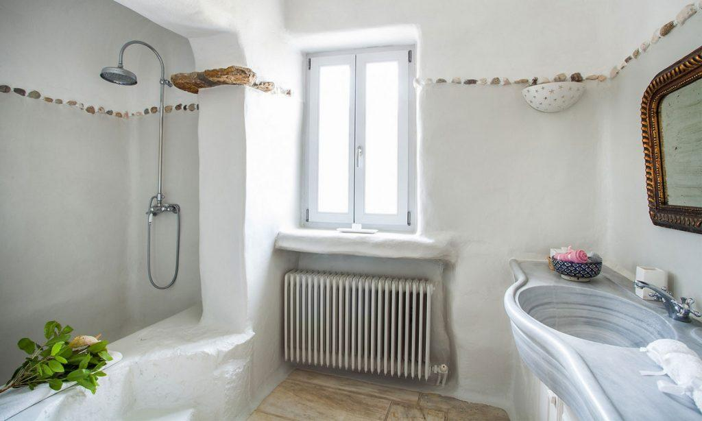 Villa Bob Agios Sostis Mykonos, 1st bathroom, shower, washstand, mirror, towels,flowers, window