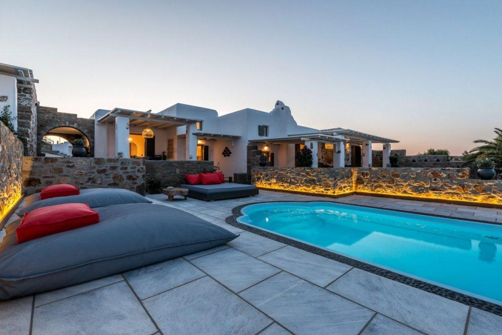 outdoor area with cozy climbers and soft red pillows