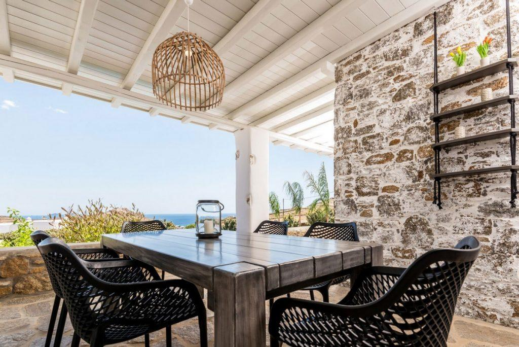 outdoor area with table and black designed chairs