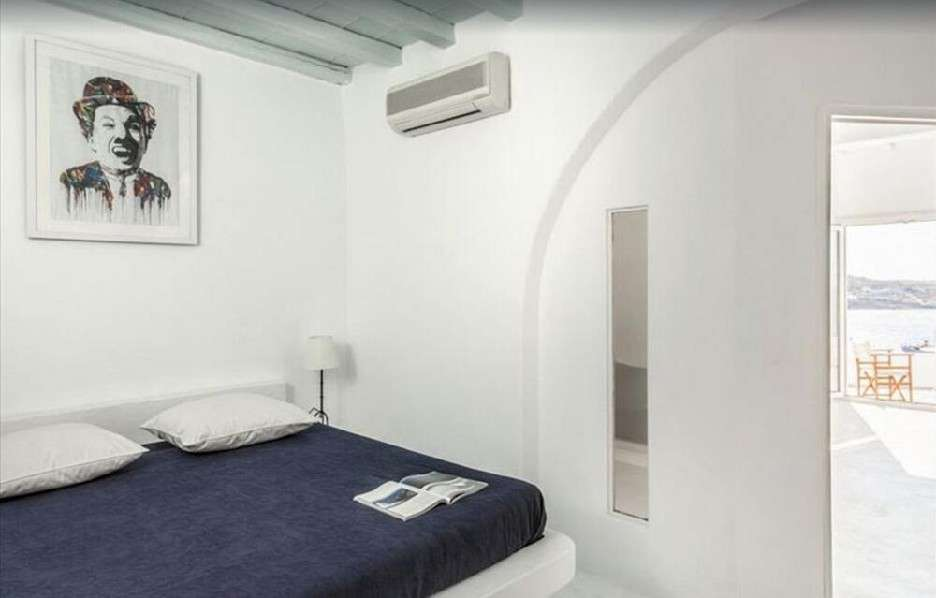 bedroom with air condition to cool down and bed to rest in
